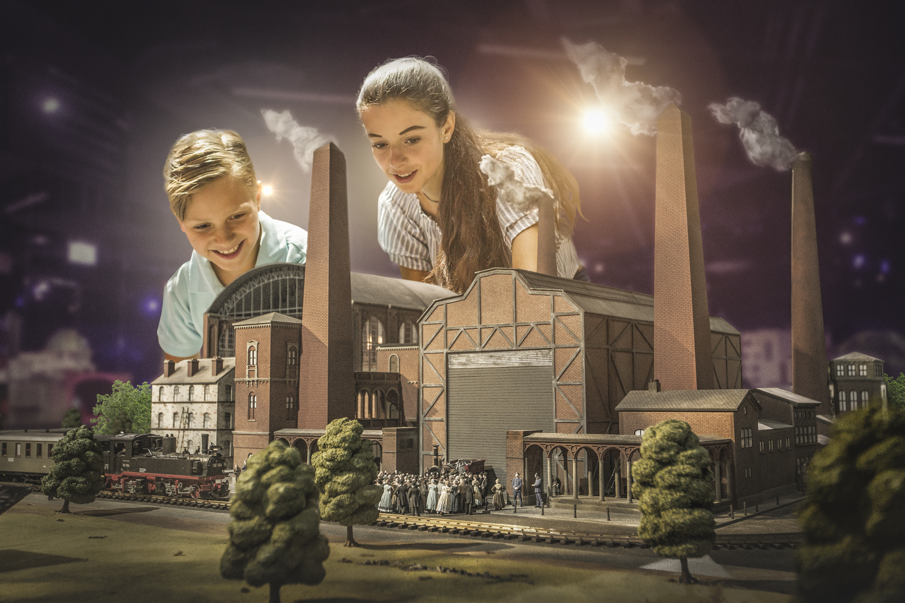 a couple of kids watch a historical reconstruction of a factory at Little BIG CityBerlin