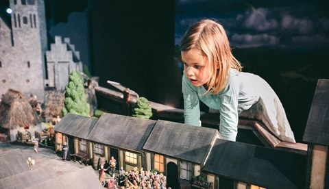 Little girl watches a historical miniature of medieval Berlin at Little BIG City Berlin